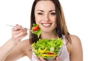 beautiful-young-girl-eats-salad-29616070